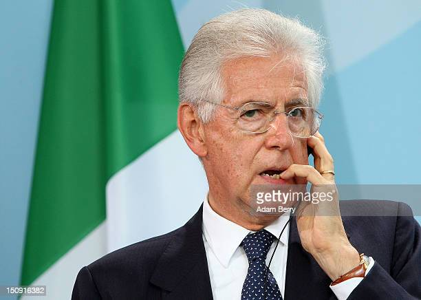 Italian Prime Minister Mario Monti pauses during a news conference with German Chancellor Angela Merkel at the German federal Chancellory on August...