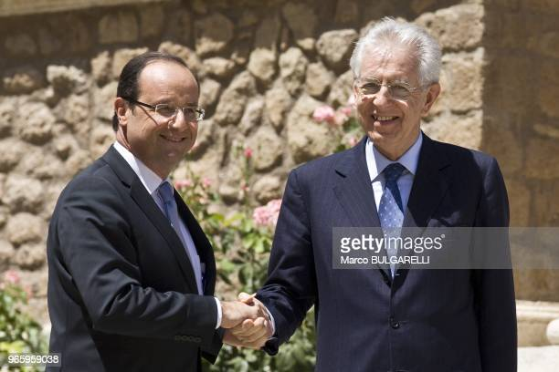 Italian Prime Minister Mario Monti welcoming French President Francois Hollande before their meeting at Villa Madama on June 22 2012 in Rome in Italy