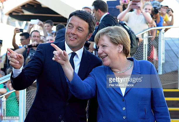 Italian Prime Minister Matteo Renzi and German Chancellor Angela Merkel attend the visit at the pavilion of Germany during the visit of German...