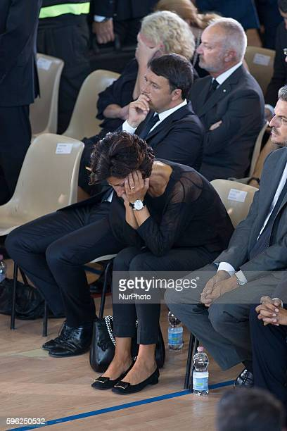 Italian Prime Minister Matteo Renzi and his wife Agnese Landini attend a funeral mass for victims of earthquake on August 27, 2016 in Ascoli Piceno,...