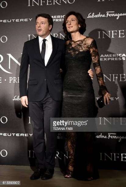 Italian Prime Minister Matteo Renzi and his wife Agnese Landini arrive at the world premiere of the movie 'Inferno' on October 8 2016 in Florence /...