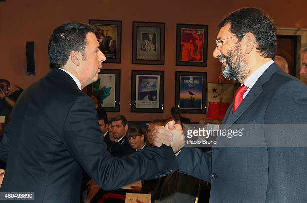 Italian Prime Minister Matteo Renzi and Rome's Mayor Ignazio Marino shake the hands at the ceremony of the announce of Rome's candidacy to host the...