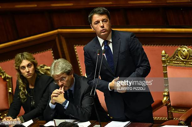 Italian Prime Minister Matteo Renzi delivers a speech focused on the next European Council next to Foreign Affairs Minister Paolo Gentiloni and the...
