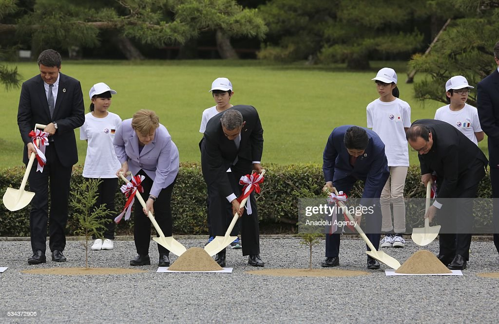 Italian Prime Minister Matteo Renzi, German Chancellor Angela Merkel, US President Barack Obama, Japanese Prime Minister Shinzo Abe, and French President Francois Hollande participate to the tree planting ceremony at Ise-Jingu Shrine during the first day of the G7 leaders summit in the city of Ise in Mie prefecture, Japan on May 26, 2016.
