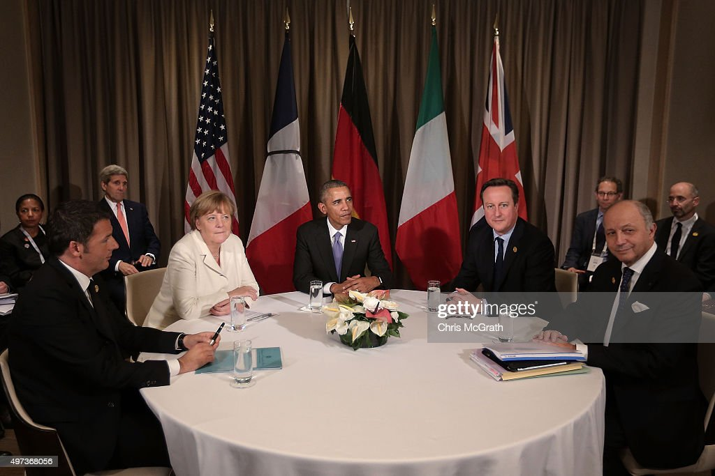 Italian (L-R) Prime Minister Matteo Renzi, Germany's Chancellor Angela Merkel, U.S President Barack Obama, British Prime Minister David Cameron and French Minister of Foreign Affairs and International Development Laurent Fabius talk during a round table meeting on day two of the G20 Turkey Leaders Summit on November 16, 2015 in Antalya, Turkey. World leaders will use the summit to discuss issues including, climate change, the global economy, the refugee crisis and terrorism. The two day summit takes place in the wake of the massive terrorist attack in Paris which killed more than 120 people.