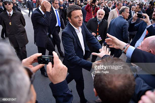 Italian Prime Minister Matteo Renzi meets supporters during an election campaign rally on May 14 2014 in Palermo Italy Prime Minister Matteo Renzi...