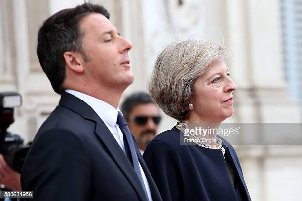 Italian Prime Minister Matteo Renzi receives British Prime Minister Theresa May as she arrives at Villa Pamphili on July 27 2016 in Rome Italy...