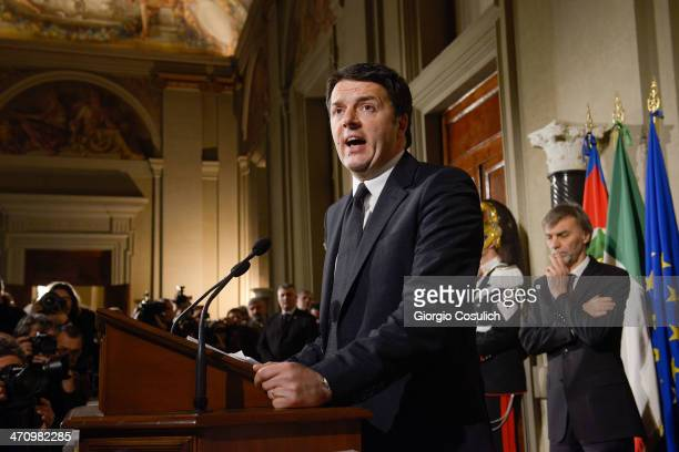 Italian Prime Minister Matteo Renzi speaks during a press conference to announce the names of his new cabinet ministers after a meeting with Italy's...