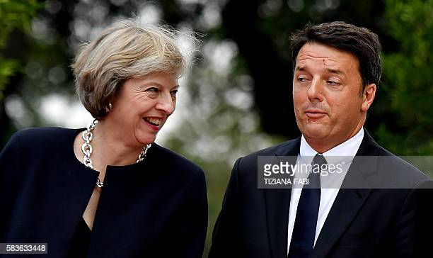 Italian Prime Minister Matteo Renzi welcomes British Prime Minister Theresa May in the garden of Villa Doria Pamphili prior to a meeting in Rome on...