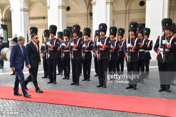 Italian Prime Minister Paolo Gentiloni and Libya's UNbacked Prime Minister Fayez alSarraj review the guard of honours during a welcome ceremony prior...