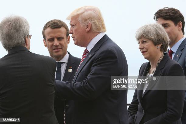 Italian Prime Minister Paolo Gentiloni French President Emmanuel Macron Britain's Prime Minister Theresa May and Canadian Prime Minister Justin...