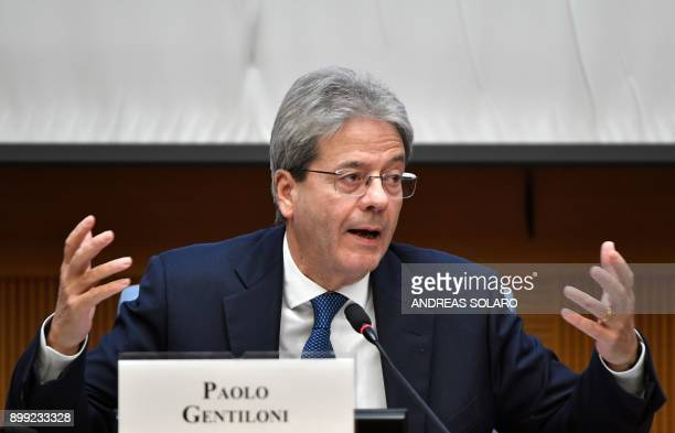 Italian Prime Minister Paolo Gentiloni gestures as he answers questions from journalists during the endofyear press conference at 'Auletta' of the...