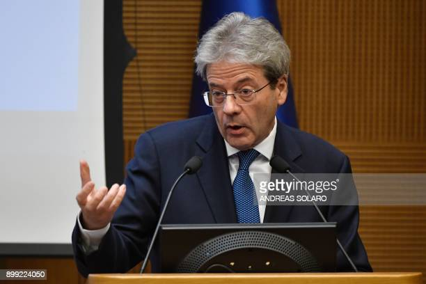 Italian Prime Minister Paolo Gentiloni gestures as he delivers a speech during the endofyear press conference at 'Auletta' of the parliamentary...