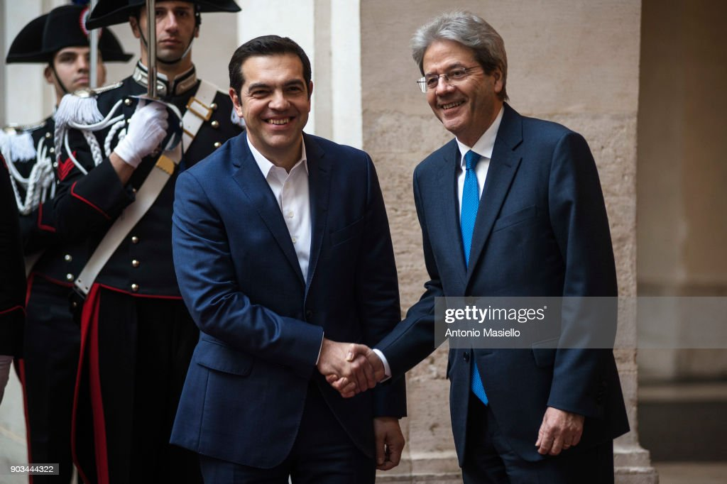 Italian Prime Minister Paolo Gentiloni (R) greets Greek Prime Minister Alexis Tsipras (L) before a bilateral meeting, ahead of the 4th summit of Southern European countries, at Palazzo Chigi on January 10, 2018 in Rome, Italy. The Greek PM is in Rome for the 4th summit of Southern European countries on migration and EU future attended by the leaders of Italy, France, Greece, Spain, Portugal, Malta, and Cyprus.