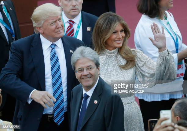 Italian Prime Minister Paolo Gentiloni looks on as US President Donald Trump and US First Lady Melania Trump arrive for a concert of the La Scala...