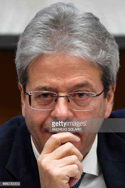 Italian Prime Minister Paolo Gentiloni reacts as he answers questions from journalists during the endofyear press conference at 'Auletta' of the...