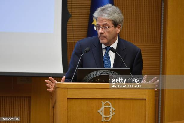 Italian Prime Minister Paolo Gentiloni reacts as he delivers a speech during the endofyear press conference at 'Auletta' of the parliamentary groups...
