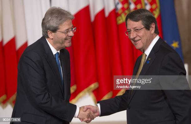Italian Prime Minister Paolo Gentiloni shakes hands with Greek Cypriot leader Nikos Anastasiadis upon his arrival to attend the 4th Summit of...