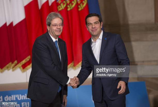 Italian Prime Minister Paolo Gentiloni shakes hands with Greek Prime Minister Alexis Tsipras upon his arrival to attend the 4th Summit of Southern...