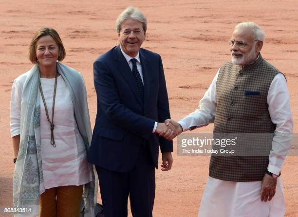 Italian Prime Minister Paolo Gentiloni shakes hands with Prime Minister Narendra Modi as he arrives for a ceremonial reception at the President's...