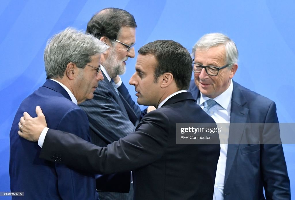 Italian Prime Minister Paolo Gentiloni, Spain's Prime Minister Mariano Rajoy, French President Emmanuel Macron and President of the European Commission Jean-Claude Juncker leave after a press conference on June 29, 2017 at the Chancellery in Berlin following a meeting with European G20 heads of State in order to prepare the upcoming G20 summit scheduled on July 7-8, 2017. / AFP PHOTO / John MACDOUGALL