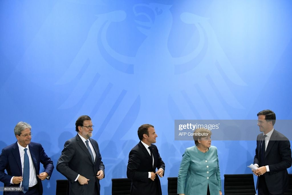 Italian Prime Minister Paolo Gentiloni, Spain's Prime Minister Mariano Rajoy, French President Emmanuel Macron, German Chancellor Angela Merkel and Netherland's Prime Minister Mark Rutte leave after a press conference on June 29, 2017 at the Chancellery in Berlin following a meeting with European G20 heads of State in order to prepare the upcoming G20 summit scheduled on July 7-8, 2017. / AFP PHOTO / John MACDOUGALL