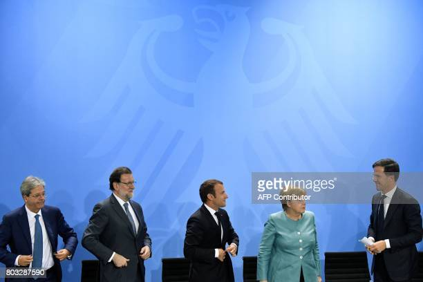 Italian Prime Minister Paolo Gentiloni Spain's Prime Minister Mariano Rajoy French President Emmanuel Macron German Chancellor Angela Merkel and...