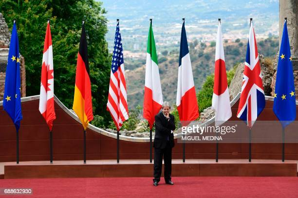 Italian Prime Minister Paolo Gentiloni stands on stage before the welcome ceremony at the ancient Greek Theatre of Taormina during the Heads of State...