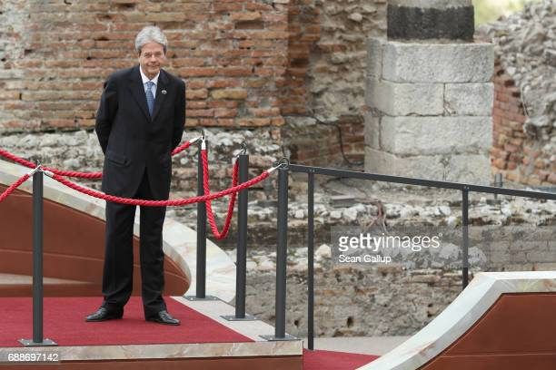 Italian Prime Minister Paolo Gentiloni waits for other G7 leaders to arrive in the ancient amphiteater at the G7 Taormina summit on the island of...
