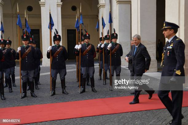 Italian Prime Minister Paolo Gentiloni walks past the honor guard during official welcome ceremony for President of European Council Donald Tusk at...