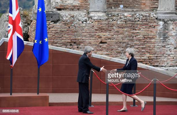 Italian Prime Minister Paolo Gentiloni welcomes Britain's Prime Minister Theresa May as she arrives for the Summit of the Heads of State and of...