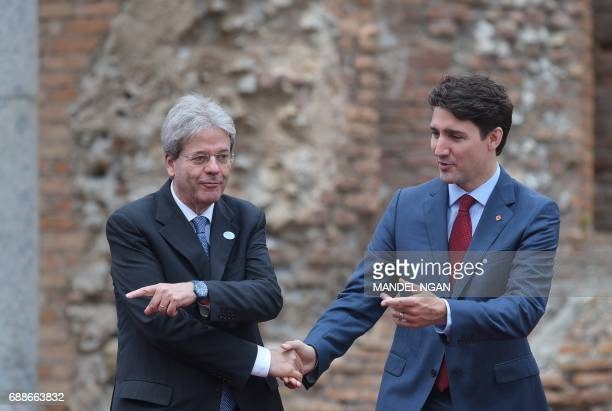 Italian Prime Minister Paolo Gentiloni welcomes Canada's Prime Minister Justin Trudeau as he arrives for the Summit of the Heads of State and of...