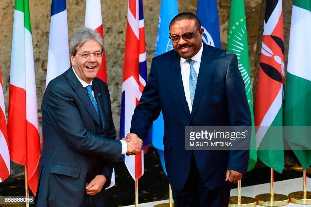 Italian Prime Minister Paolo Gentiloni welcomes Ethiopian Prime Minister Hailemariam Desalegn as he arrives at the Hotel San Domenico on the second...