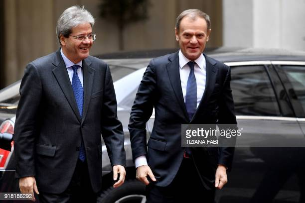 Italian Prime Minister Paolo Gentiloni welcomes European Council President Donald Tusk as he arrives for a meeting at the Palazzo Chigi in Rome on...