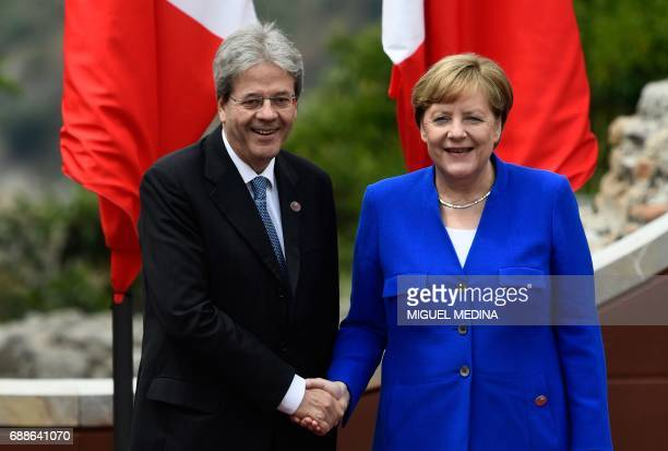 Italian Prime Minister Paolo Gentiloni welcomes German Chancellor Angela Merkel as she arrives for the Summit of the Heads of State and of Government...