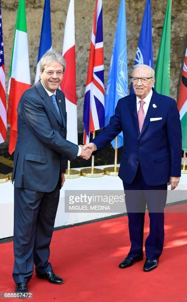 Italian Prime Minister Paolo Gentiloni welcomes Tunisian President Beji Caid Essebsi as he arrives at the Hotel San Domenico on the second day of the...
