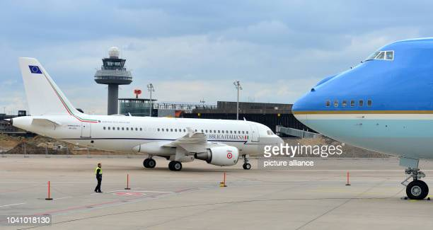 Italian Prime Minister Renzi arriving on an Airbus A319 and passing the Air Force One the plane of the US President at the airport of Hanover Germany...