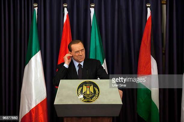 Italian Prime Minister Silvio Belusconi makes a face during a joint press conference with Palestinian President Mahmud Abbas at the Presidents...
