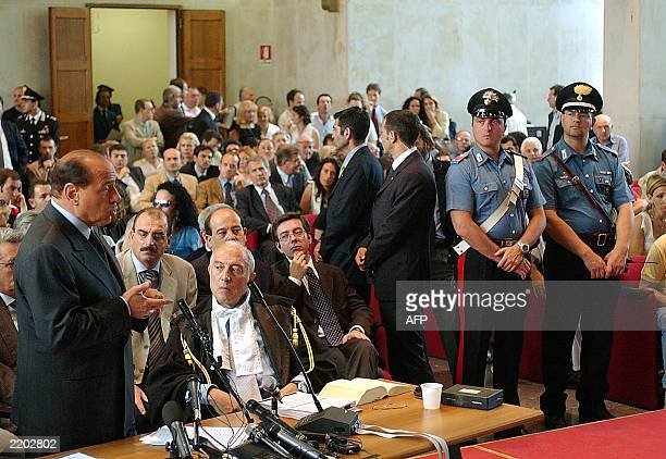 Italian Prime Minister Silvio Berlusconi addresses a courtroom in central Milan, 17 June 2003. Berlusconi arrived in a Milan court on Tuesday to...