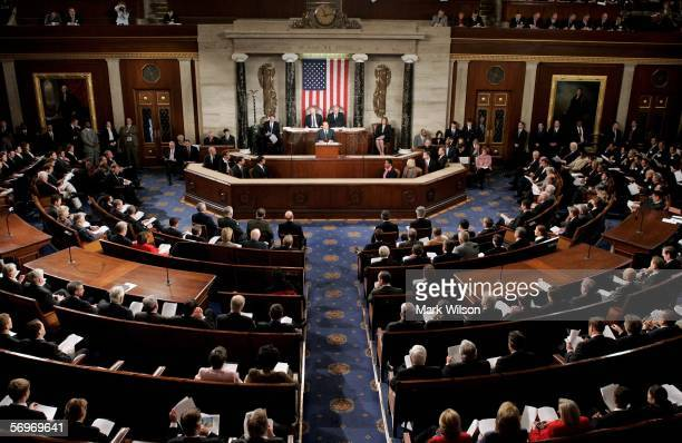 Italian Prime Minister Silvio Berlusconi addresses US legislators in the chamber of the US House of Representatives at the US Capitol during a joint...