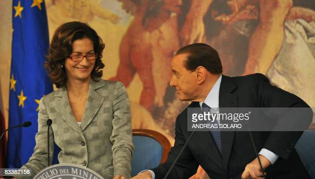 Italian Prime Minister Silvio Berlusconi and education minister Mariastella Gelmini take place for a press conference on October 22 2008 at the Prime...