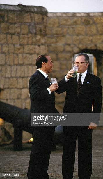 Italian Prime Minister Silvio Berlusconi and European Commission President Jacques Delors attend a working dinner for the international leaders at...