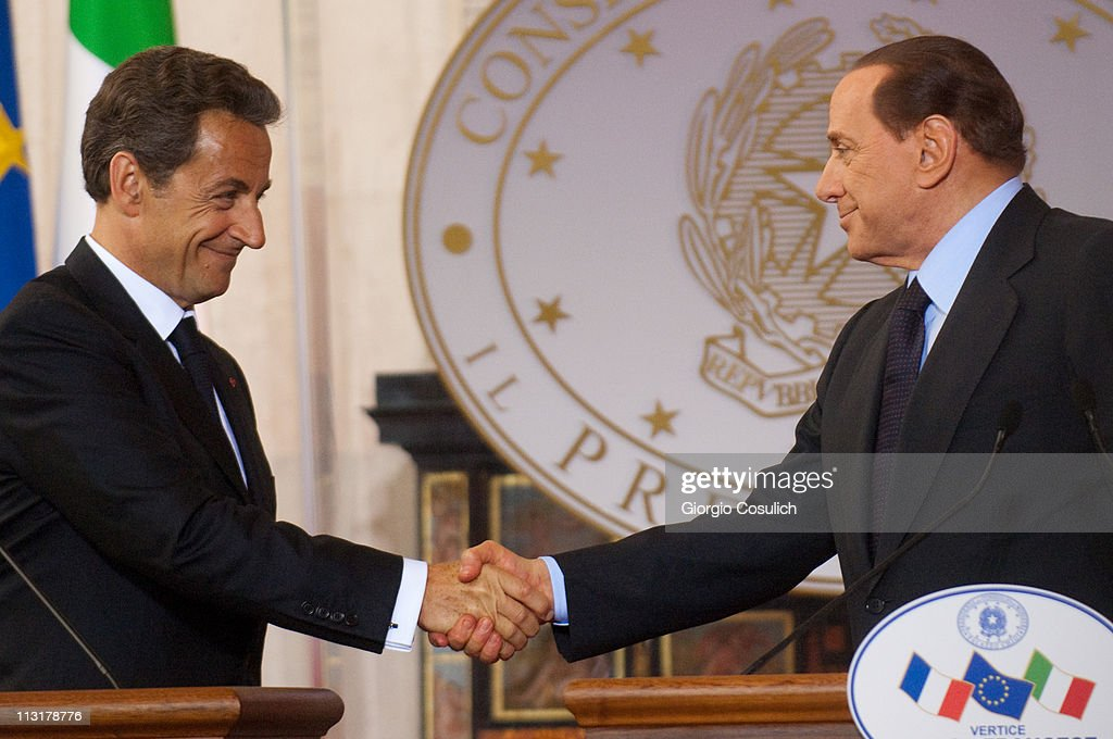 Italian Prime Minister Silvio Berlusconi (R) and French President Nicolas Sarkozy shake hands at the end of the Italy-France Summit at Villa Madama on April 26, 2011 in Rome, Italy. The two leaders discussed the immigration crisis and the possible opening of nuclear power plants among other topics during the Italy-France summit.