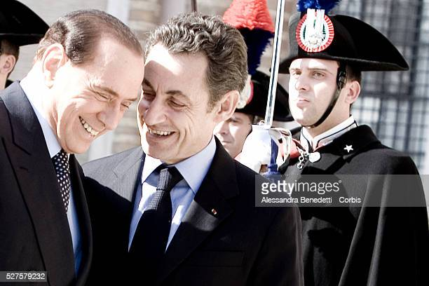 Italian Prime Minister Silvio Berlusconi and French President Nicolas Sarkozy arrive at Villa Madama for a bilateral meeting between France and Italy