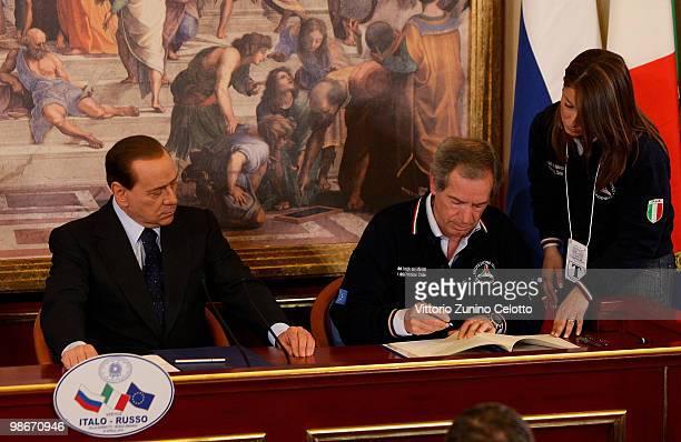 Italian Prime Minister Silvio Berlusconi and Head of Italian Civil Protection Guido Bertolaso attend a press conference held at Villa Gernetto on...