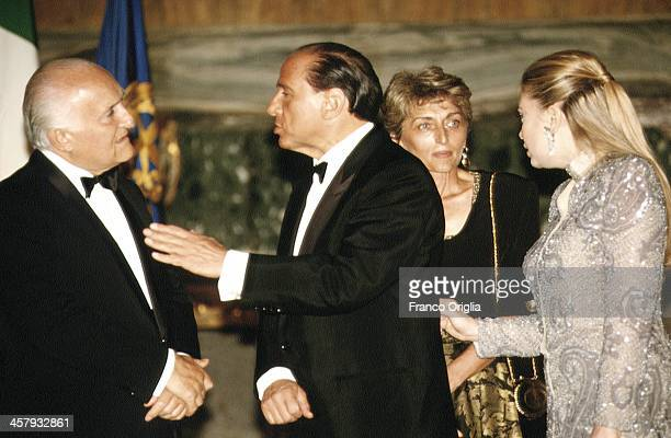 Italian Prime Minister Silvio Berlusconi and his second wife Veronica Lario chat with President of the Italian Republic Oscar Luigi Scalfaro and his...