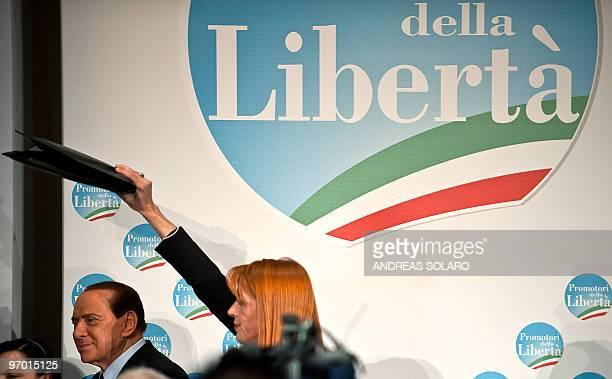Italian Prime Minister Silvio Berlusconi and his Tourism minister Michela Vittoria Brambilla leave a meeting to promote a candidate for the next...