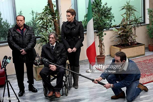 Italian Prime Minister Silvio Berlusconi and Italian politician Daniela Santanche face a media gathering alongside Alberto Torregiani, the son of...