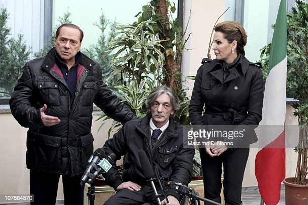Italian Prime Minister Silvio Berlusconi and Italian politician Daniela Santanche face media alongside Alberto Torregiani, the son Pierluigi...