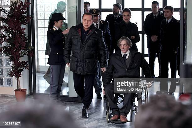 Italian Prime Minister Silvio Berlusconi and Italian politician Daniela Santanche arrive alongside Alberto Torregiani, the son of Pierluigi...